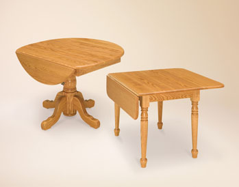 The table base style can alter the look of any table as shown here. Amish Furniture Factory