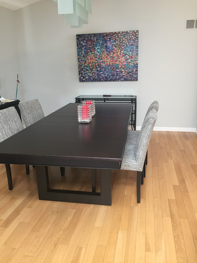 Kalispel Dining Table with square trestle legs in modern-style dining room