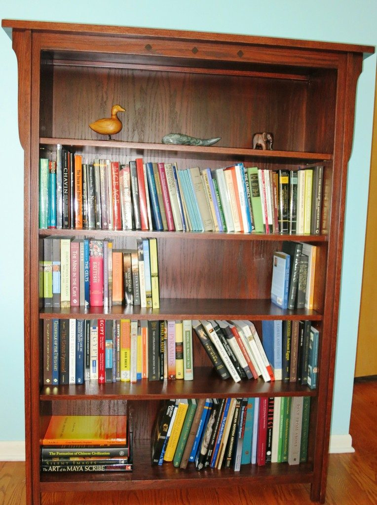 The Royal Mission 4865 Bookcase in Oak with Acres stain is four feet wide by six feet high