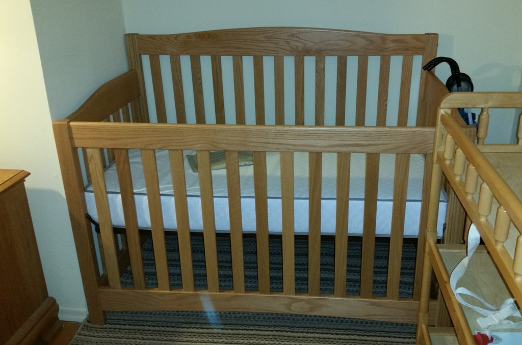 The Monterey Convertible Crib converts a child's bed when your child is ready. Shown in oak with Wheat stain from Amish Furniture Factory