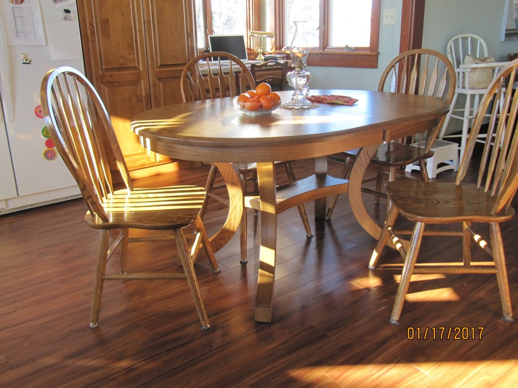 The Carlisle Dining Table in oak with Sealy stain from Amish Furniture Factory
