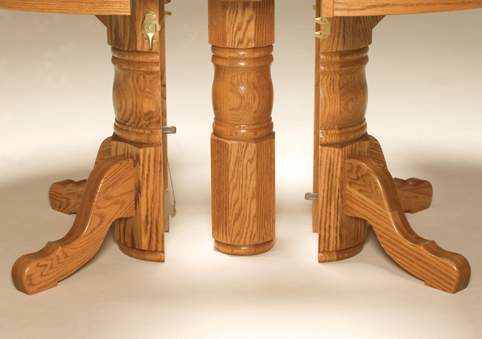 The Split Pedestal Dining Table looks like a single pedestal table, but it can open to create a triple pedestal table and seat up to 18!—Amish Furniture Factory