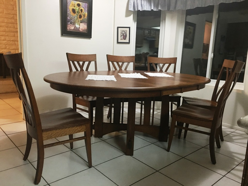 The Brookville Dining Table and Oleta Dining Chairs in quarter-sawn white oak with Michael's Cherry stain from Amish Furniture Factory