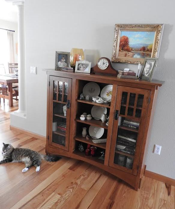 Marie's cat likes the Mission Display Bookcase in cherry with Baywood Stain from Amish Furniture Factory.