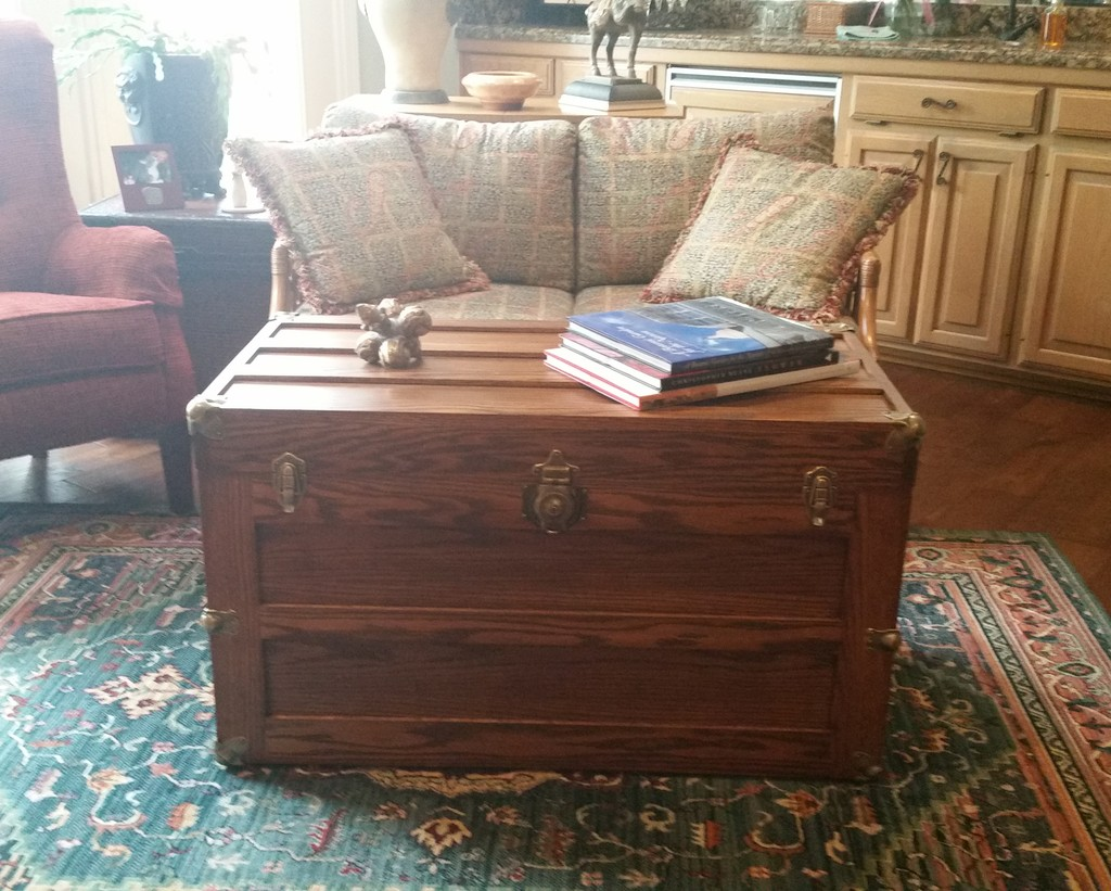 Amish Trunk with Flat Lid in oak with Acorn stain being used as a coffee table in the midst of living room upholstered living room seating—Amish Furniture Factory