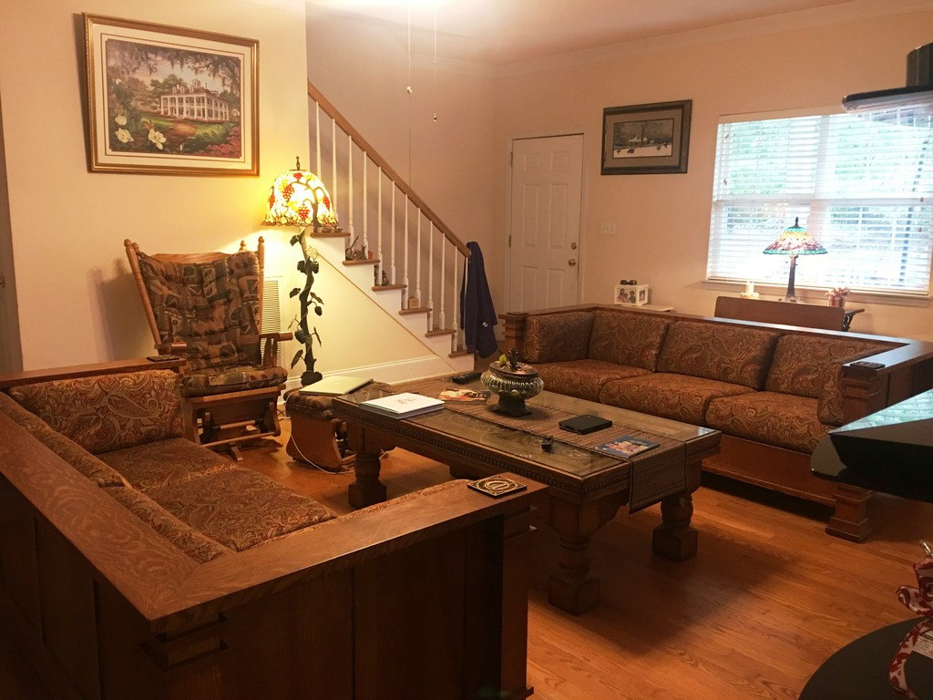 The Diamond Sofa from Amish Furniture Factory has bare solid wood arms and outer back, with upholstered seat, inner back, and inner arms. Dale has two facing each other around a coffee table, with coasters on the handy arm rests.
