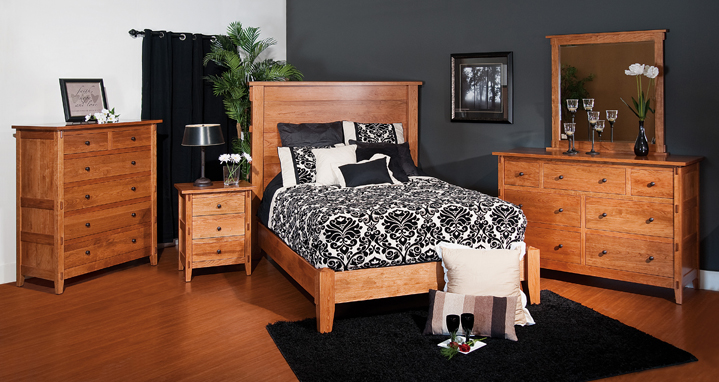 The Bungalow Bedroom Set has squared off silhouettes and exposed mortise joints. The bed can have a very high paneled headboard. From Amish Furniture Factory