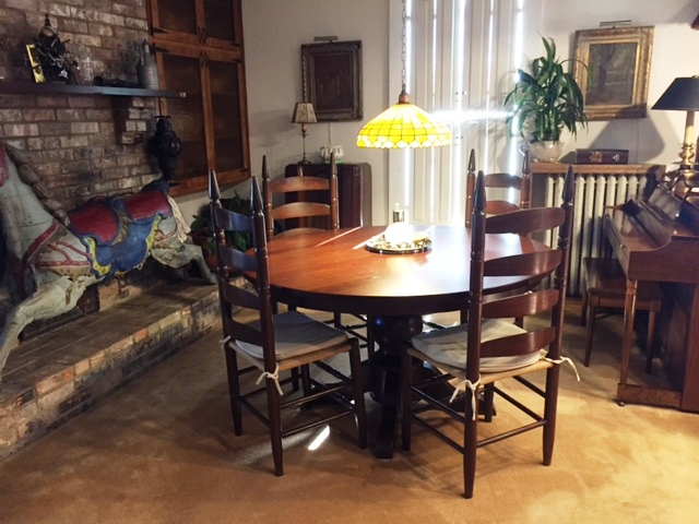 Carson Single Pedestal Dining Table in walnut with Acres stain, with smooth table top option from Amish Furniture Factory