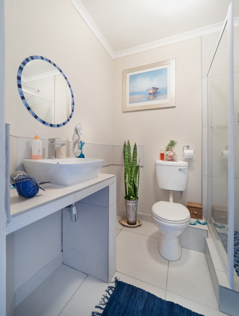 Brighten up a windowless bathroom by adding enough lighting in addition to reflective decor.