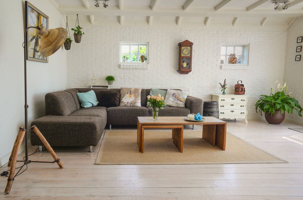 Brighten up a basement apartment by adding light colors and arranging furniture to use the natural light.