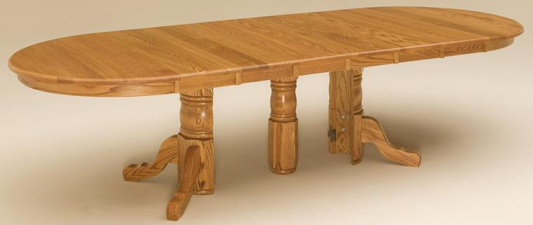 A split-pedestal dining table shown with 6 leaves