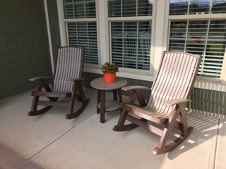 Two Poly Vinyl Comfort Rockers and a Poly Vinyl Deluxe End Table in color weatherwood with chestnut brown legs and trim