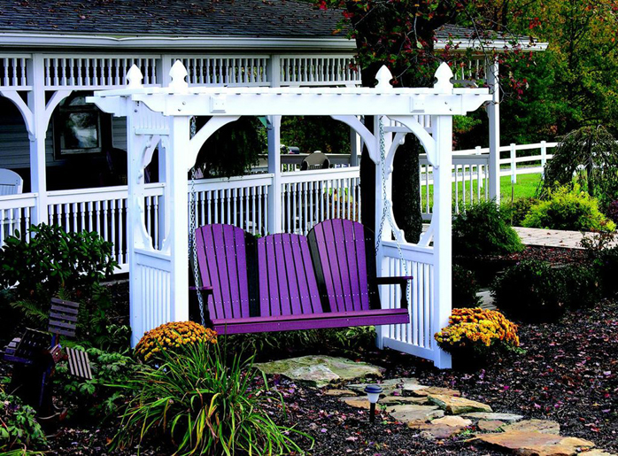 A 5' Adirondack Poly Vinyl Swing in purple and black on a Classic White Poly Vinyl Swing Stand from Amish Furniture Factory