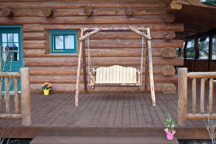 Glacier Country Lawn Swing hanging from an A-frame from Amish Furniture Factory