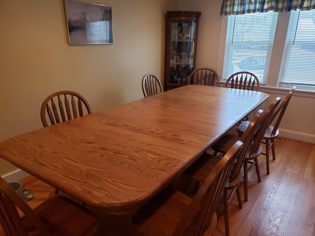 This Double Pedestal Dining Table has all four leaves in for a length of ten feet.—Amish Furniture Factory