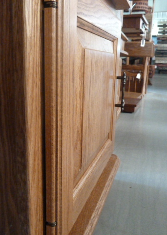 A deeply angled view of a raised furniture door panel from Amish Furniture Factory