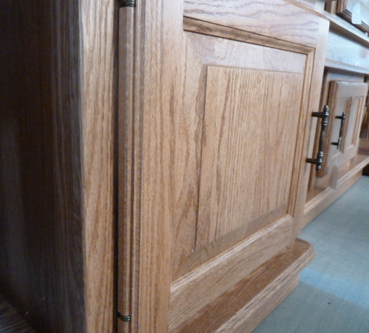 An angled view of a raised panel furniture door from Amish Furniture Factory