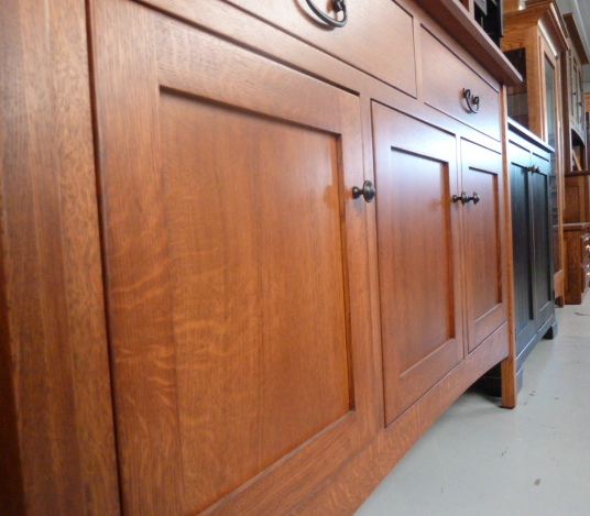 An angled view of a reverse panel furniture door from Amish Furniture Factory
