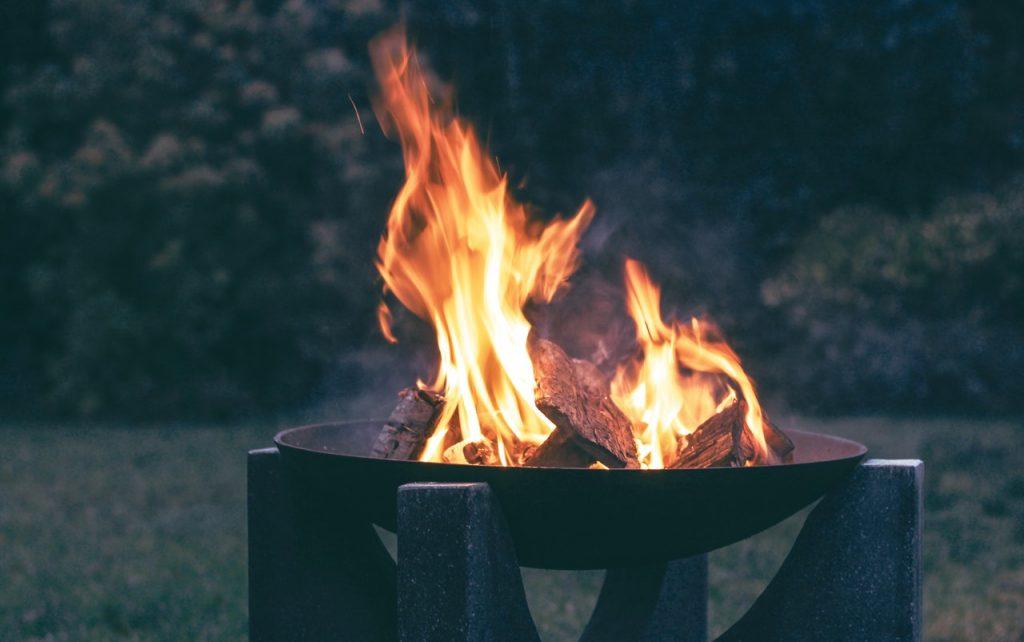 A backyard camp fire in a patio fire pit.