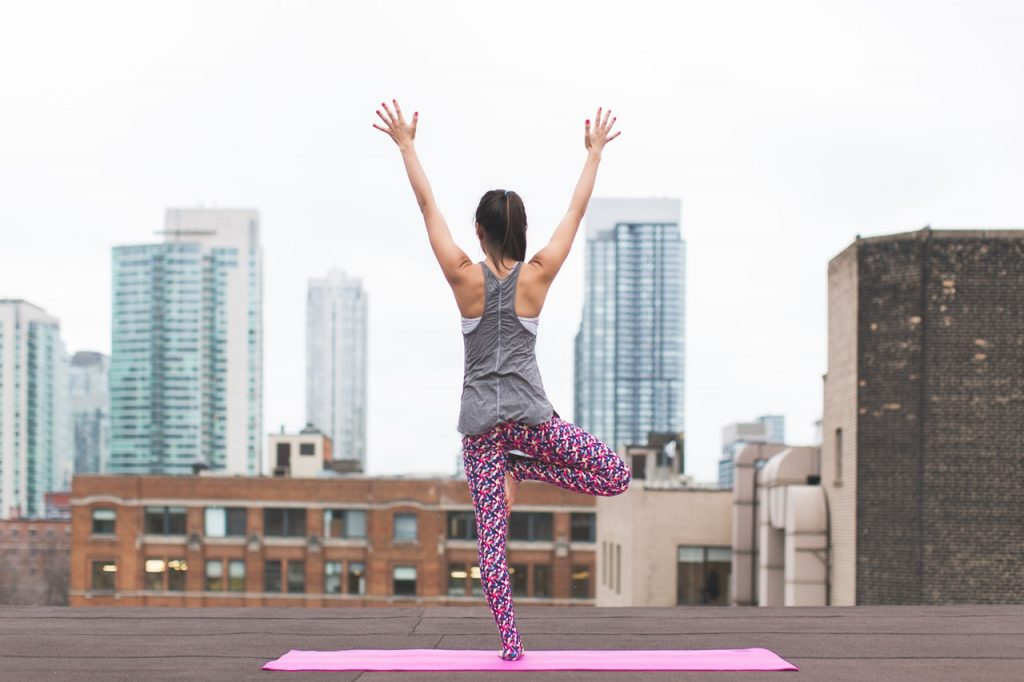 Even in the middle of the city, you only need a little space to bring your yoga outside.