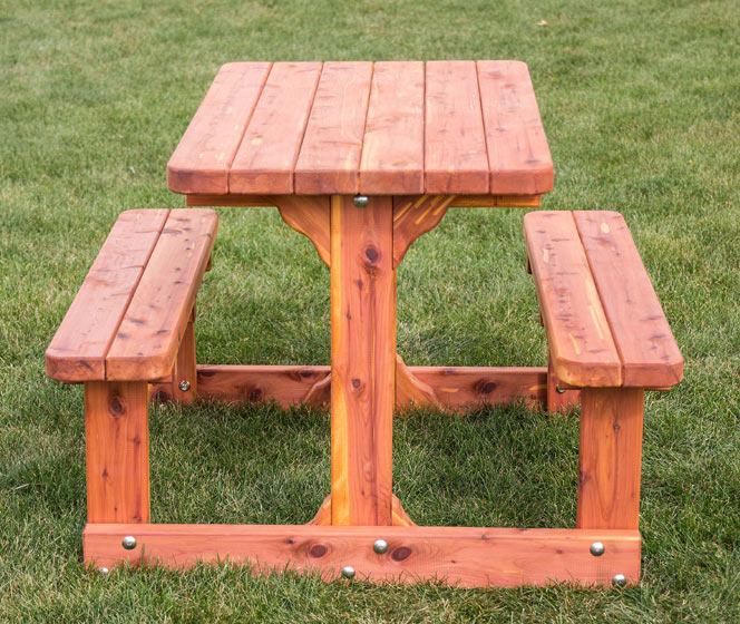 This child-sized picnic table is built in aromatic red cedar and milled for a smooth finish to prevent splinters. From Amish Furniture Factory