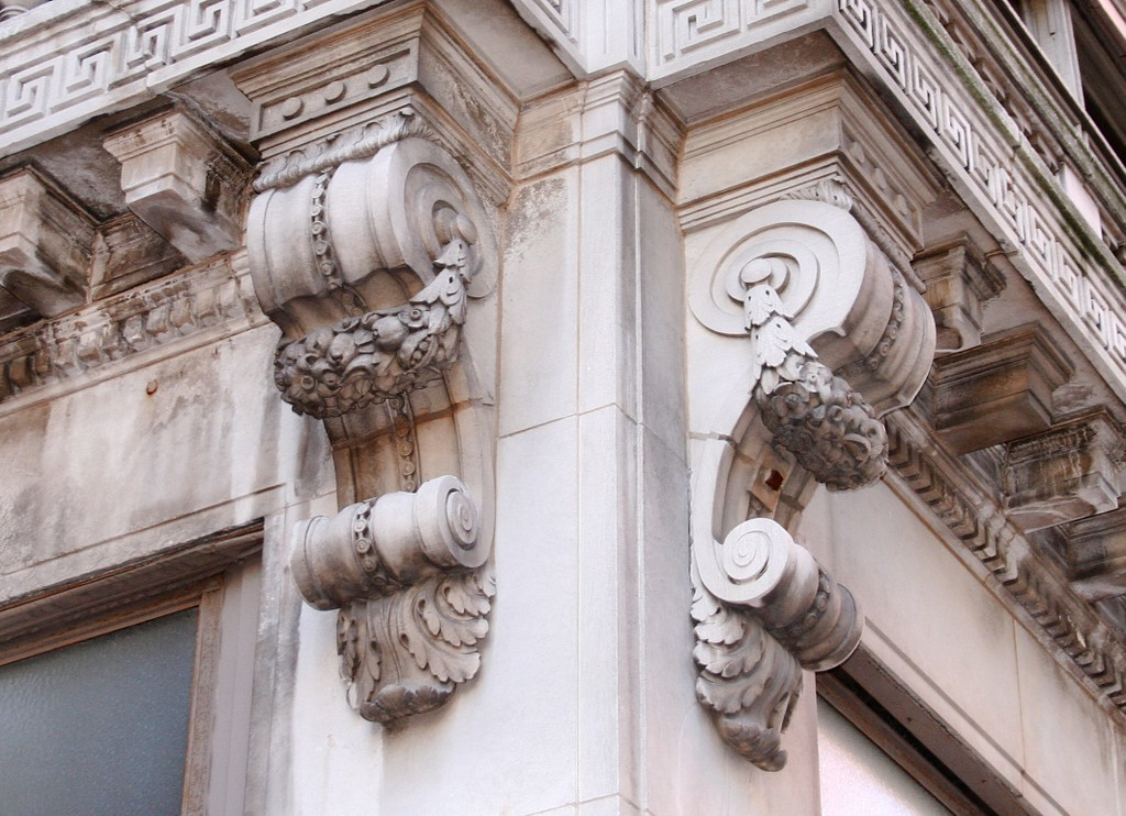 Stone corbels on the corner of a neoclassical building in Indianapolis