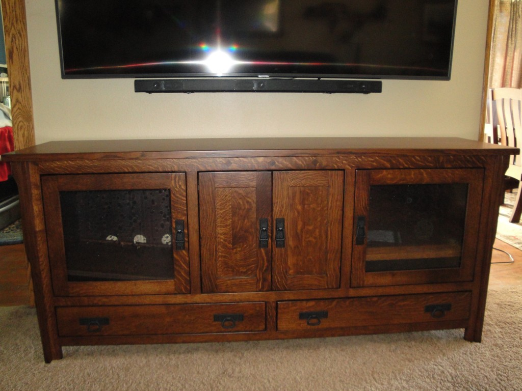 Mounting her TV on the wall lets Peggy use her TV stand to store more electronics and decorate with its beautiful woodgrain.